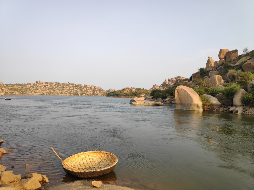Coracle boats which are ... Ruins of Hampi. MemExp Blog