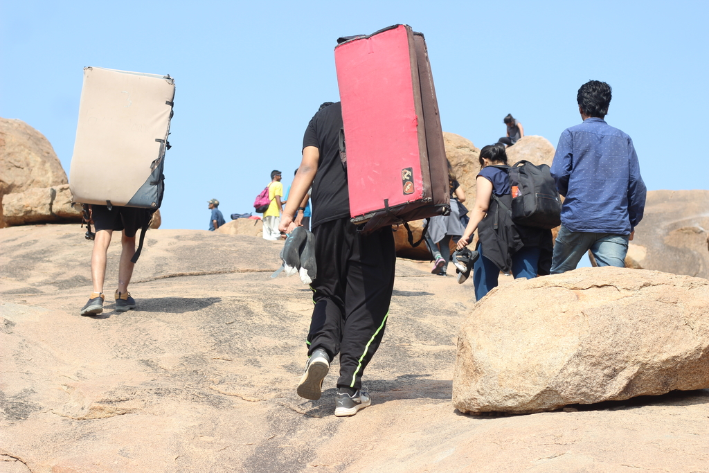 Carrying the cushions fo... Ruins of Hampi. MemExp Blog